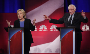 Hillary Clinton and Bernie Sanders speak simultaneously at the NBC News - YouTube Democratic presidential candidates debate in Charleston, South Carolina, January 17, 2016. REUTERS/Randall Hill