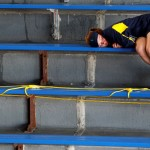 A girl naps in the stands at the U.S. Open tennis tournament in New York August 27, 2012. REUTERS/Jessica Rinaldi